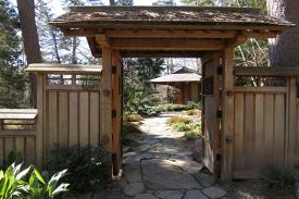 A wooden archway that leads to the Duke Gardens teahouse.