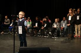 Spellers line up on the stage at the 2017 Duke University Regional Spelling Bee.