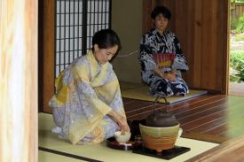 Practitioners prepare tea for a traditional Japanese tea gathering.