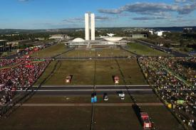 photo of Brazil parliament and protest crowds