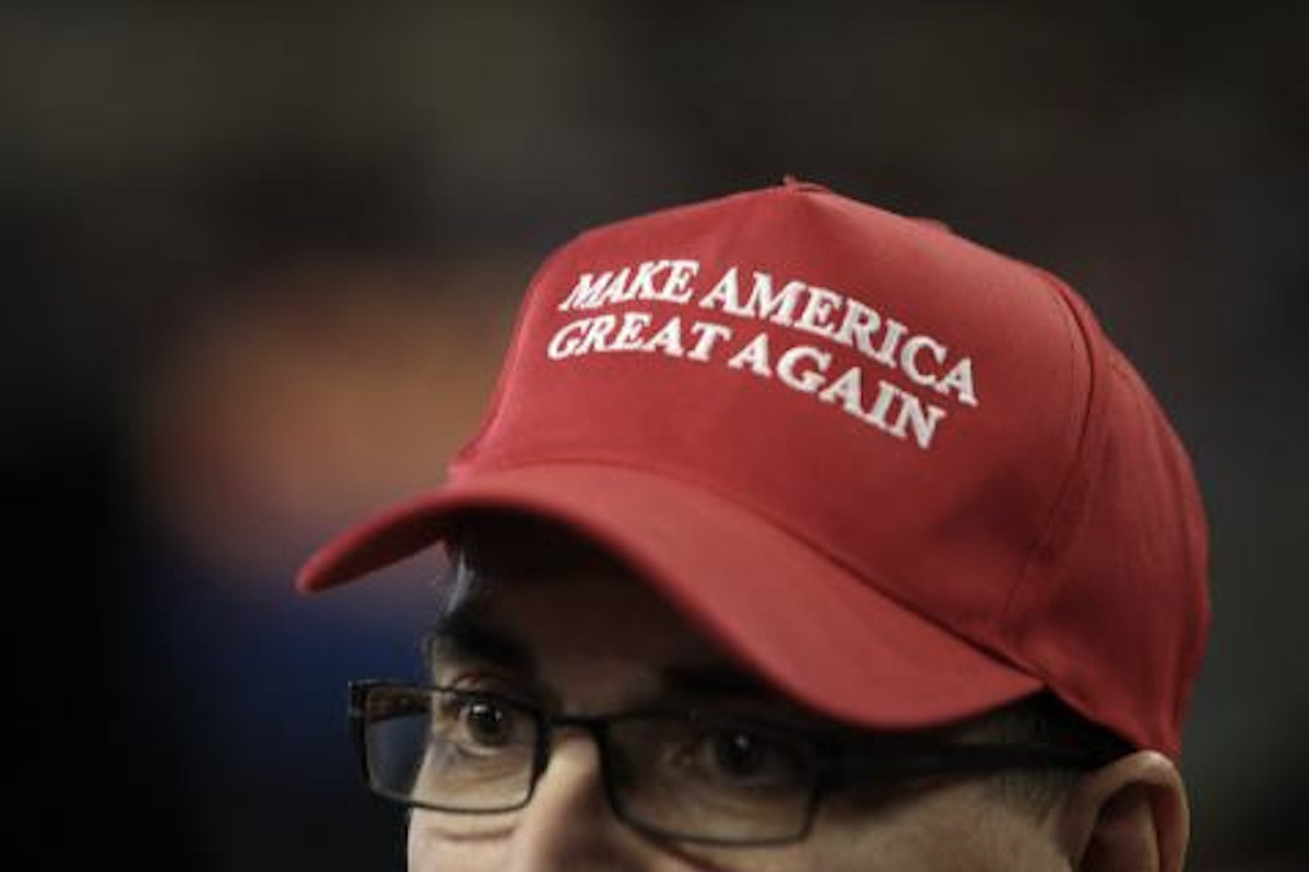 Image of man in a Make America Great Again hat