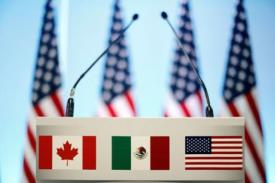 image of podium with Canadian, Mexican, US flags