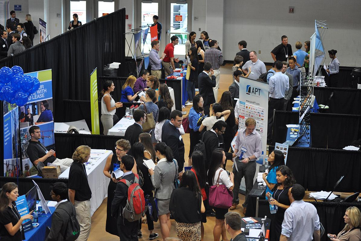 students attending a busy career fair