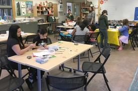 Families learning in Duke Gardens' classroom