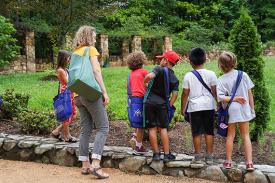 Students at Duke Gardens explore nature.