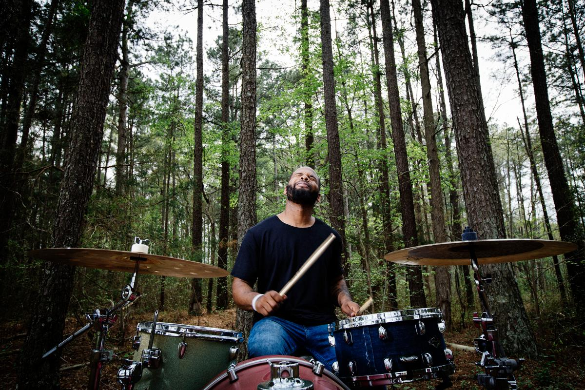 Man playing drums in the woods
