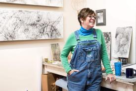 Artist Kiki Farish in her studio in front of artwork.