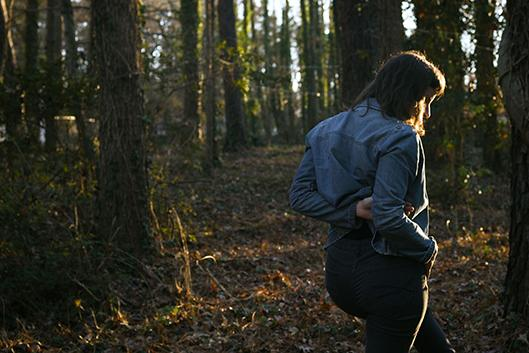 Woman wandering in a forest.