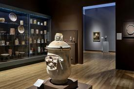 Installation view of <em>The New Galleries: A Collection Come to Light</em>, featuring the Art of the Americas Gallery, presenting ceramics, metalwork and textiles from Mesoamerica. Photo by Peter Paul Geoffrion.
