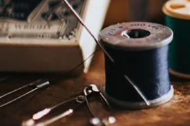 safety pins, sewing box and spool of black thread