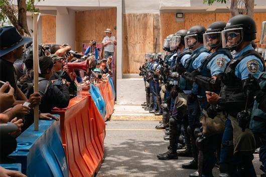 Photo of police confronting protestors