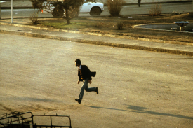Man running at night during the Iranian Revolution