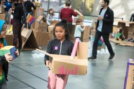Children make a city out of boxes at the Nasher