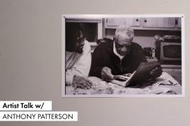 Artist Talk with Anthony Patterson. A photograph of Anthony looking at a photo album with his grandfather.