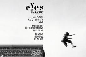 Lisa Gualtieri-Alford, Brooklyn, NY, USA 2003. Eyes on Main Street. Bringing the World to Wilson. A young boy parkours off a roof.