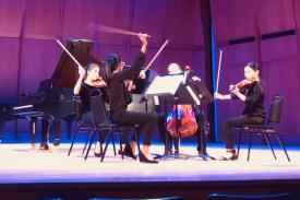 Students playing in an orchestra.