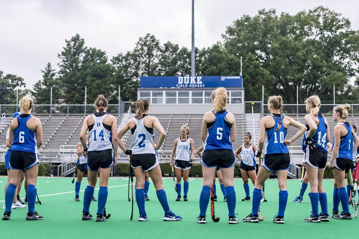 Field hockey players in huddle