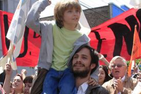 photo from film No: Gael García Bernal carries boy in a protest