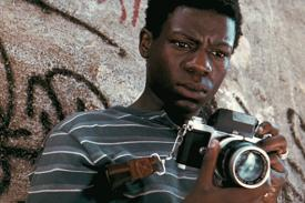 photo from film City of God: boy with camera
