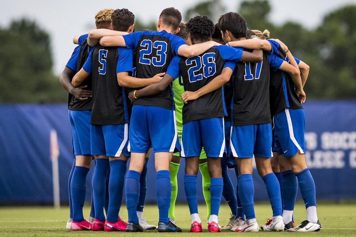 soccer players in huddle