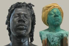 two sculptures of busts, one male one female