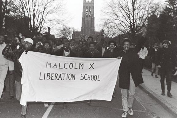 Black students leave the campus after vacating the Allen Administration Building in the wake of its takeover to protest the campus racial climate. Photograph by Harold Moore, courtesy of The Herald-Sun