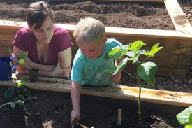 Parent and child gardening together