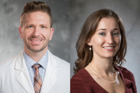 Dr. Christopher Lunsford (left) wears his white coat and a salmon and blue plaid tie with a light blue shirt. Marion Quirici (right) wears a dark red shirt and pearls on her neck.