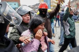 photo of protestor being arrested by police in Bolivia