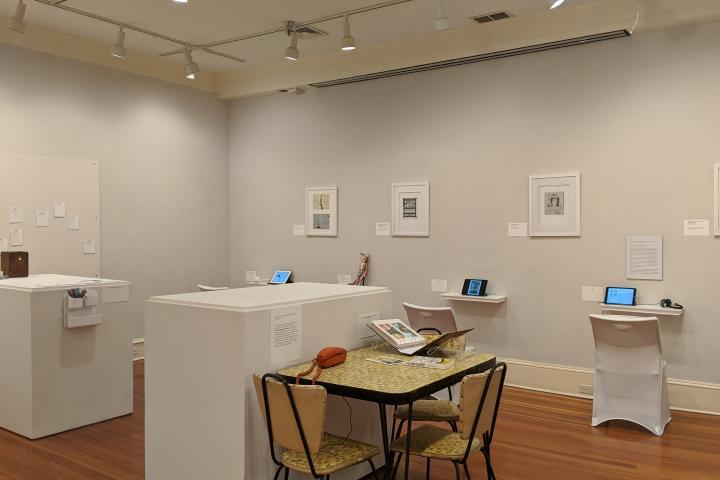 "A still from the ""ar·ti·facts: Abortion Stories and Histories"" exhibit. Multiple stations set up with stories of peoples' abortion experiences."