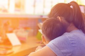 image of child learning from teacher or caregiver