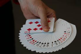 Hand holding a deck of cards