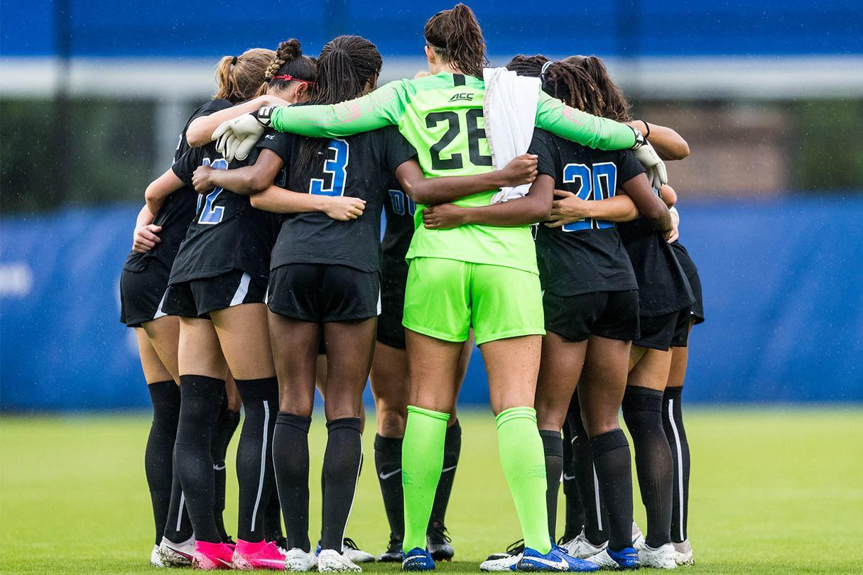 Duke soccer players in huddle