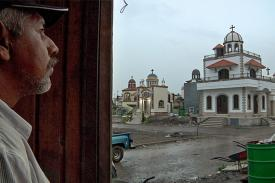 photo from film El Velador, Nightwatchman looks out over the cemetery