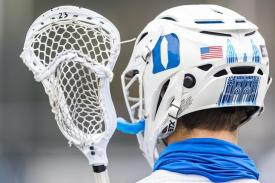 player holding lacrosse stick