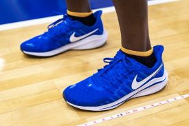 basketball player wearing Duke blue sneakers