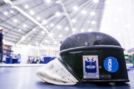 Duke fencing mask with competition in background