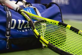 tennis racket and Duke duffle bag