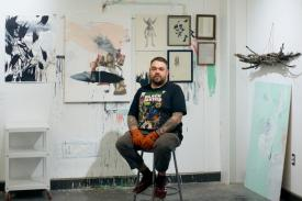 Image of John Felix Arnold III with his artwork
