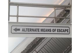 "Image of a sign reading ""alternate means of escape"""
